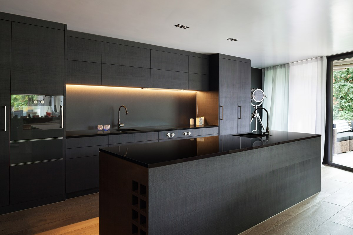 Modern Kitchen With Black Benchtop